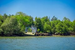 Outdoor view of destroyed house at mangroves in Krabi Province, Andaman Sea, South of Thailand.  Stock Photography