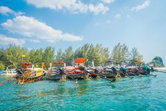 Outdoor view of Fishing thai boats in a row in Po-da island, Krabi Province, Andaman Sea, South of Thailand.  Stock Photos