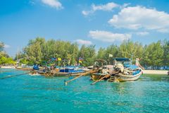 Outdoor view of Fishing thai boats in a row in Po-da island, Krabi Province, Andaman Sea, South of Thailand.  Royalty Free Stock Photos