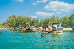 Outdoor view of Fishing thai boats in a row in Po-da island, Krabi Province, Andaman Sea, South of Thailand.  Royalty Free Stock Image