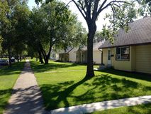 Outdoor view at houses. Nice view at private houses, buildings and apartments during sunshine day. Winnipeg, Canada Royalty Free Stock Image