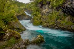 Outdoor view of long exposure of the Petrohue River located in Llanquihue Province, Los Lagos Region, Chile.  stock photos