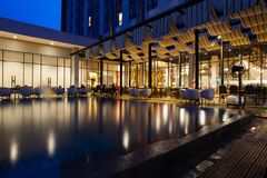 Outdoor view of modern restaurant building. Reflection on water stock images