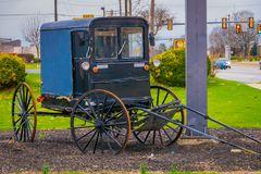 Outdoor view of old Amish carriage parked at one side of the rural road in Lancaster County. Pennsylvania Royalty Free Stock Image