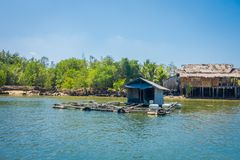 Outdoor view of old and damaged house floating in the river close to the mangroves in Krabi Province, South of Thailand.  Royalty Free Stock Photo