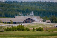 Outdoor view of old faithful geyser area. View of the Old Faithful Inn. One of the most famous and historical hotels in. Yellowstone in Usa stock photo