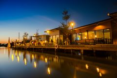 Outdoor view of restaurant reflection on water. At sunset timing located at Bangkok Thailand stock photo