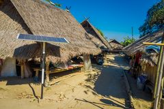 Outdoor view of solar pannel close to traditional houses of Long Neck trib, Kayan Lahwi, northern Thailand.  Stock Image
