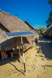 Outdoor view of solar pannel close to traditional houses of Long Neck trib, Kayan Lahwi, northern Thailand.  Stock Photo