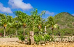 Outdoor view of some stoned structures close to a coconut palm trees in a caribbean Beach in beautifunny sunny day and. Blue sky in playa hermosa in Mexico Royalty Free Stock Photo