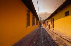 Outdoor view of stoned street with some old building houses and the historic city Antigua is UNESCO World Heritage Site. Since 1979 in Guatemala Stock Image