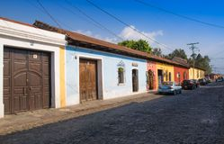 Outdoor view of stoned street with some old building houses and the historic city Antigua is UNESCO World Heritage Site. Since 1979 in Guatemala royalty free stock photos