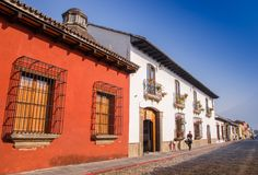 Outdoor view of stoned street with some old building houses and the historic city Antigua is UNESCO World Heritage Site. Since 1979 in Guatemala royalty free stock images