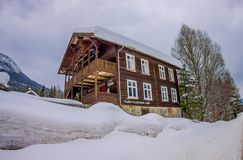 Outdoor view of taditional Norwegian mountain houses of wood covered with snow in stunning nature in Norway.  Stock Photos