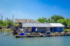 Outdoor view of very old and damaged house floating in the river located at fish farms in Krabi Province, South of. Thailand Stock Photography