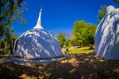 Outdoor view of white building in form of dome in Baan Dam or Black House, Museum of Art in Chiang Rai, Thailand.  Royalty Free Stock Photo