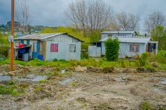 Outdoor view of wooden house buildings located in Ancud Village Houses, in Chiloe Island Chile royalty free stock photo