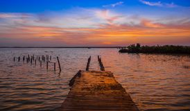 Outdoor view of wooden pier and Bacalar Lagoon suring a gorgeous sunset view in Mayan Mexico at Quintana roo, seven. Color lakein Mexico Stock Photography