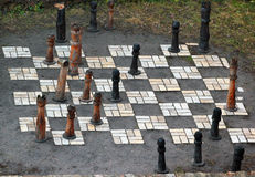 Outdoor vintage chess board with big wooden pieces Stock Photography