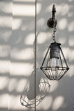 Outdoor vintage electric light with shadow hanging Royalty Free Stock Image