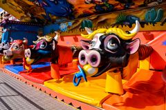 Outdoor vintage flying cow carousel. In the the city stock image