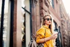 Outdoor waist up portrait of young beautiful woman with long hair. Model wearing stylish sunglasses, clothes, holding bag. City li. Festyle. Copy space for text Stock Images