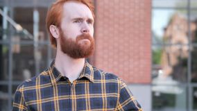 Outdoor Waiting Redhead Beard Young Man Watching Time on Watch. 4k high quality, 4k high quality stock video