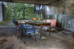 Outdoor waiting room. Urban exploration, found this table and chairs Royalty Free Stock Image