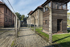 Outdoor Walkway Lined With Electrified Barbed Wire in Auschwitz Camp II. Stock Photo