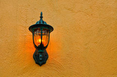Outdoor wall lamp. Beautiful outdoor wall lamp on a concrete wall stock photo