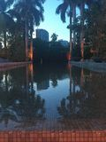 Outdoor Water Feature on Patio during Sunset in Tropical Florida. Reflections on water in ceramic tile fountain at restaurant Plant in Miami. Tropical palm trees stock photos