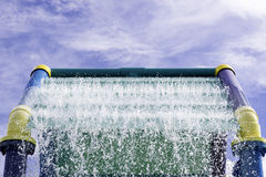 Outdoor Water Playground. Close-up of playground with blue sky on a sunny day Stock Photo