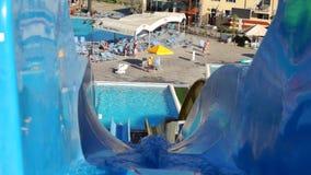 Outdoor water slide in waterpark stock video