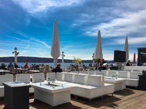 Outdoor waterfront restaurant with people eating Royalty Free Stock Photo