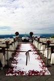 Outdoor Wedding. Chairs and red rose petals set up for an outdoor wedding Stock Photos