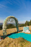 Outdoor wedding ceremony scene on a mountain slope Stock Photography