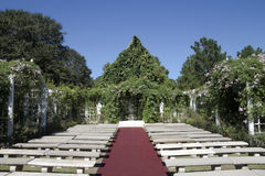 Outdoor Wedding Chapel. A outdoor wedding chapel surrounded by green vines Stock Image
