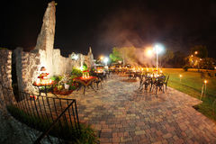 Outdoor wedding reception. Outdoor dining at a medieval wedding reception at the Coral Castle, Miami, Florida Royalty Free Stock Photos
