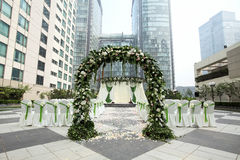 Outdoor wedding Scene. Chairs and flowers at an outdoor wedding Stock Images