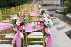 Outdoor wedding Scene. Chairs and flowers at an outdoor wedding Stock Image