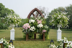 Outdoor wedding Scene. Chairs and flowers at an outdoor wedding Royalty Free Stock Image