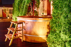 Outdoor wellnes in a wooden hot tub royalty free stock images