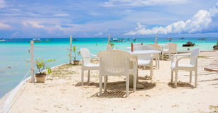 Outdoor white cafe on tropical beach Stock Images