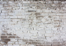 Outdoor white wall of an old brick Stock Images