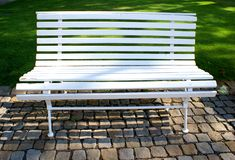 Outdoor white wooden bench Royalty Free Stock Images
