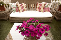 Outdoor Wicker forniture. House hold decoration objects with flowers centerpiece Royalty Free Stock Photography