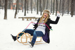 Outdoor Winter Portrait of Happy Woman on Sled Stock Image