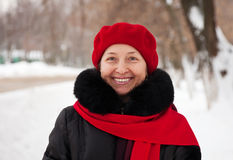 Outdoor winter portrait of mature woman. In wintry clothes Royalty Free Stock Photography
