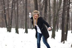 Outdoor Winter Portrait of Woman in Snowball Fight Royalty Free Stock Photos