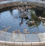 Outdoor wishing well with sculpture centerpiece. royalty free stock photo